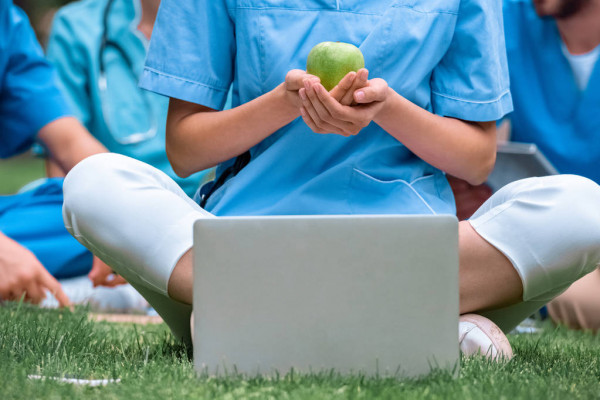 Cropped Image Medical Student Holding Ripe Green Apple Hands Sitting — стоковое фото